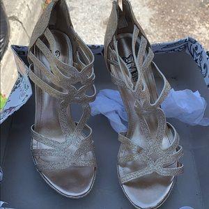 Sparkling high heeled stilletos styled rose gold